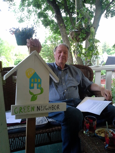 A Green Neighbor with his sign